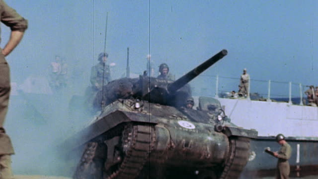s army soldiers watching m3 stuart tank drive up onto camelgreen beach from the beachhead and offloading lst / saintraphael france - tank stock videos & royalty-free footage