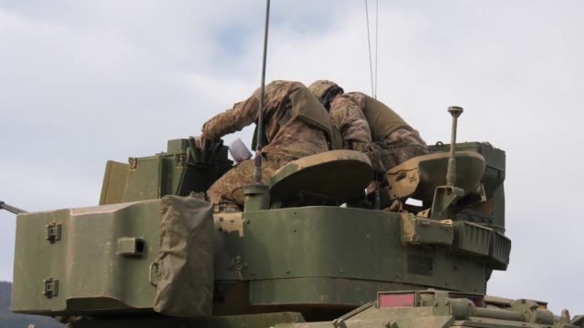 army soldiers with company b, 1st battalion, 18th infantry regiment, conduct live fire training in bradley tanks at novo selo training area, bulgaria... - 連隊点の映像素材/bロール