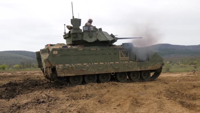 us army soldiers with company b 1st battalion 18th infantry regiment conduct live fire training in bradley tanks at novo selo training area bulgaria... - 装甲車点の映像素材/bロール