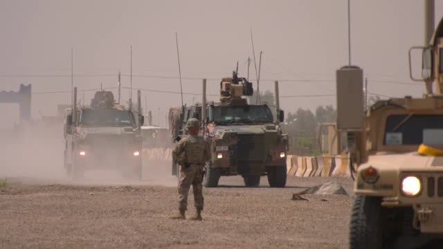army soldiers with the 321st sustainment brigade and the australian and new zealand army corps conducted a mass casualty exercise at camp taji, iraq... - イラク点の映像素材/bロール