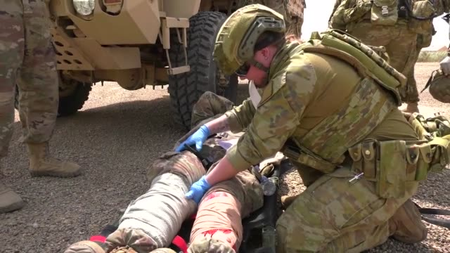 us army soldiers with the 321st sustainment brigade and the australian and new zealand army corps conducted a mass casualty exercise at camp taji... - us military stock videos & royalty-free footage