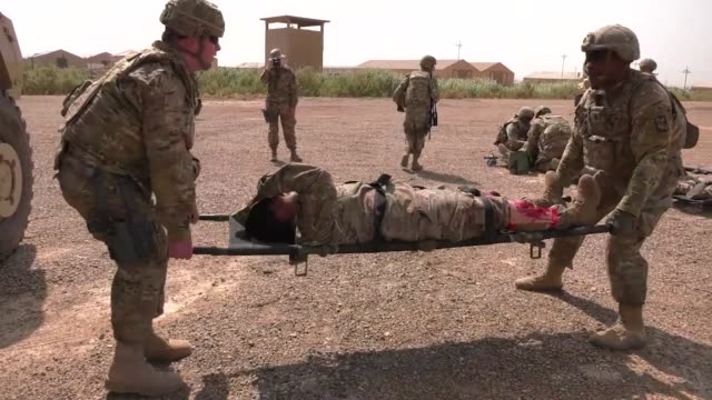 us army soldiers with the 321st sustainment brigade and the australian and new zealand army corps conducted a mass casualty exercise at camp taji... - military exercise stock videos & royalty-free footage