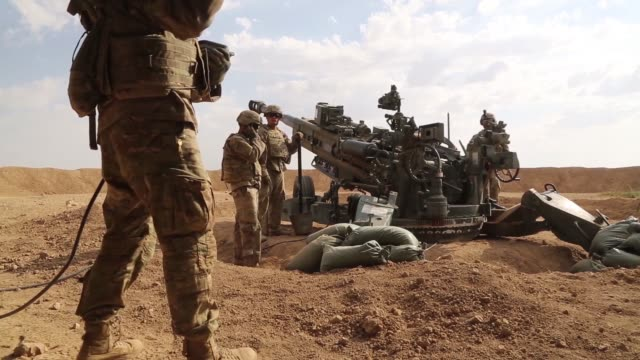 us army soldiers with the 3rd cavalry regiment fire m777 howitzer artillery alongside iraqi security force artillery at known isis locations near the... - military exercise stock videos & royalty-free footage