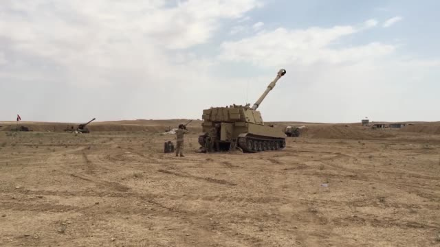 army soldiers with the 3rd cavalry regiment fire m777 howitzer artillery alongside iraqi security force artillery at known isis locations near the... - howitzer stock videos & royalty-free footage