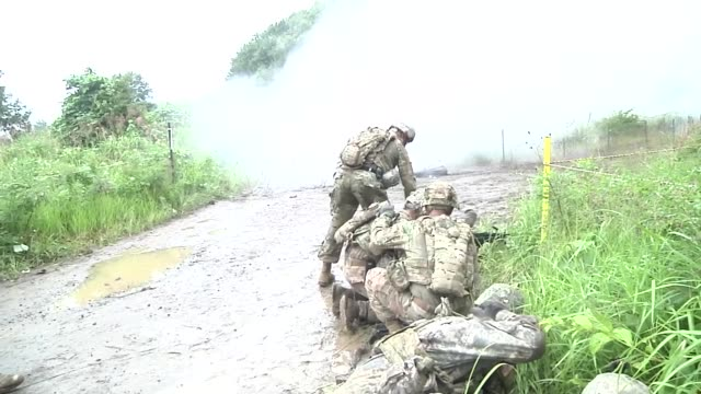 army soldiers with the 76th infantry brigade combat team assault and breach an objective during a live fire exercise in japan as a part of orient... - infantry stock videos & royalty-free footage