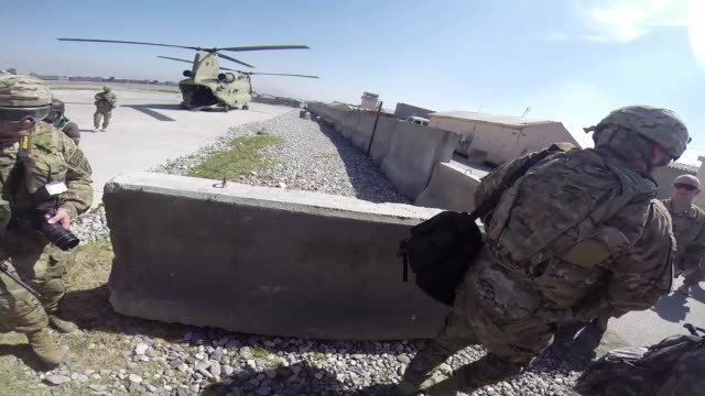 stockvideo's en b-roll-footage met us army soldiers wounded in afghanistan sit in a helicopter during a flight to forward operating base fenty on march 12 2014 near bagram afghanistan... - bagram