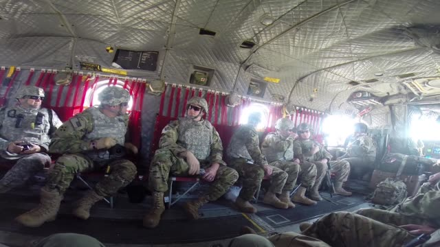 s army soldiers wounded in afghanistan sit in a helicopter during a flight to forward operating base fenty on march 12 2014 near bagram afghanistan... - バグラム点の映像素材/bロール