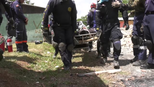 us army southsponsored foreign humanitarian assistance and disaster relief conduct a simulated rescue of casualties from a collapsed building in... - サントドミンゴ点の映像素材/bロール