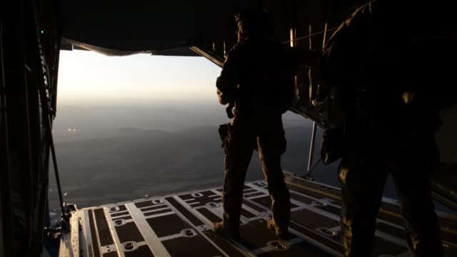 us army special operations forces soldiers conduct airborne operations training from c130 hercules at stuttgart germany february 22 2019 - fallschirm stock-videos und b-roll-filmmaterial