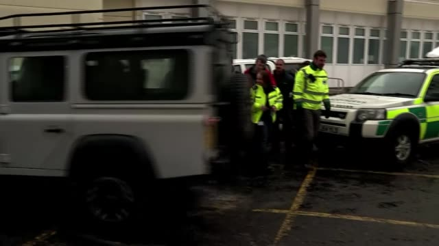 Army steps in to transport NHS staff in Edinburgh as service is stretched by bad weather SCOTLAND Glasgow EXT Member of ambulance crew walking along...