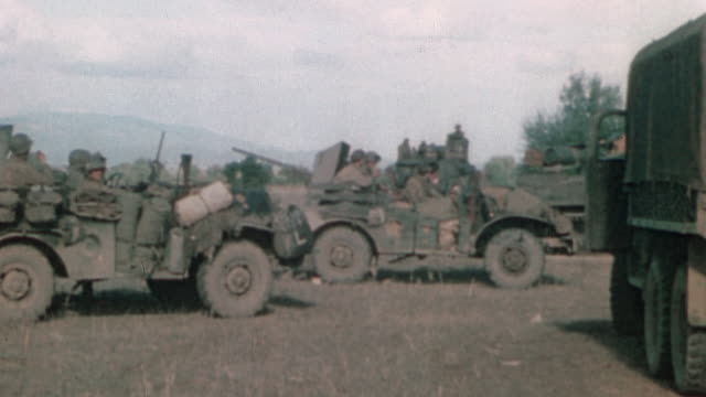 vídeos de stock, filmes e b-roll de army tank convoy moving out from bivouack during operation torch / tunisia - 1942