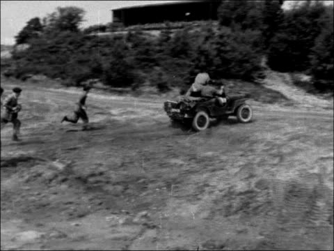 hampshire aldershot ext soldiers assembling jeep and driving off soldiers and officers watching exercises tanks across countryside during manoeuvres... - battlefield stock videos & royalty-free footage