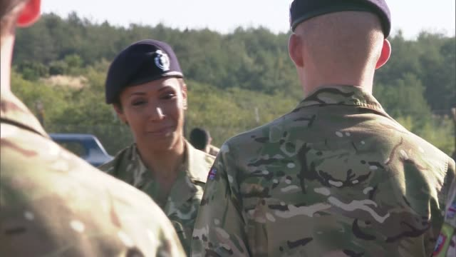 Army targets Millennials with new recruitment campaign Dorset Bovington EXT Various shots of Col Dame Kelly Holmes chatting with soldiers at a parade...