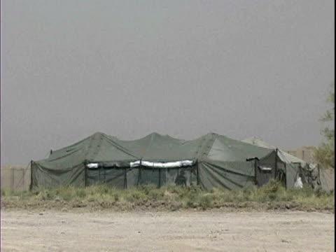army tent at patrol base hawkes / arab jabour, iraq / audio - okänt kön bildbanksvideor och videomaterial från bakom kulisserna