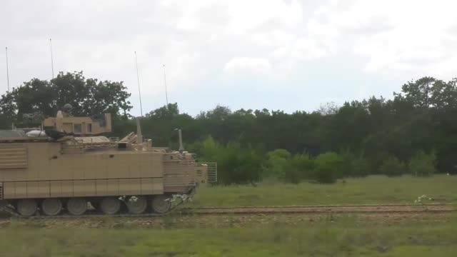 us army test command are responsible for testing and determining whether new and modernized equipment and systems are suitable effective and... - アパッチヘリコプター点の映像素材/bロール