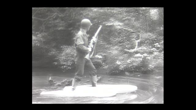 1965 us army testing walking on water near the pentagon - schwimmflügel stock-videos und b-roll-filmmaterial