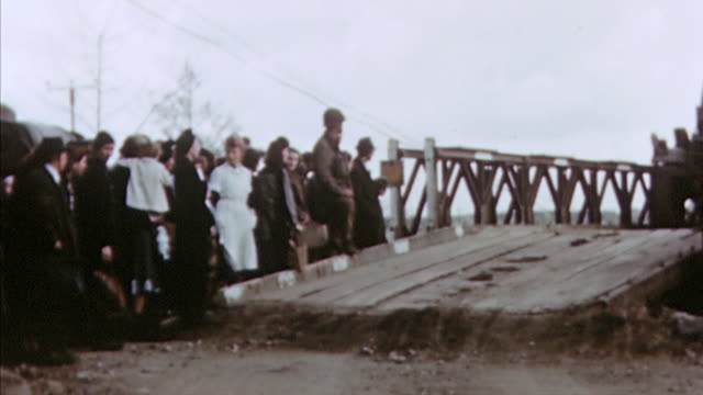 s army traffic driving over rhine river bridge while civilians wait to cross / germany - rhein stock-videos und b-roll-filmmaterial