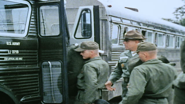 army trainees boarding bus carrying their gear and watched by drill sergeant / fort leonard wood missouri united states - sergeant stock videos & royalty-free footage