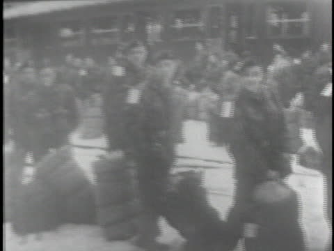 stockvideo's en b-roll-footage met us army troops wait at a railroad station in belgium - (war or terrorism or election or government or illness or news event or speech or politics or politician or conflict or military or extreme weather or business or economy) and not usa