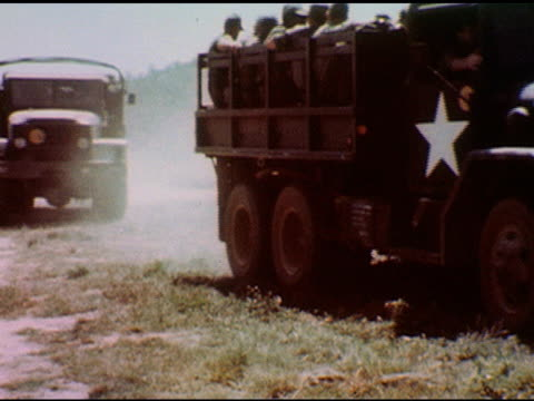 / army trucks loaded with soldiers approach and stop, soldiers unload / soldiers stand in line formation, commanding sergeant on platform / soldiers... - sergeant stock videos & royalty-free footage