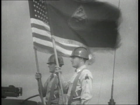 army trucks / men in trucks holding flags / tanks parading down road / soldiers in tank - 1951点の映像素材/bロール