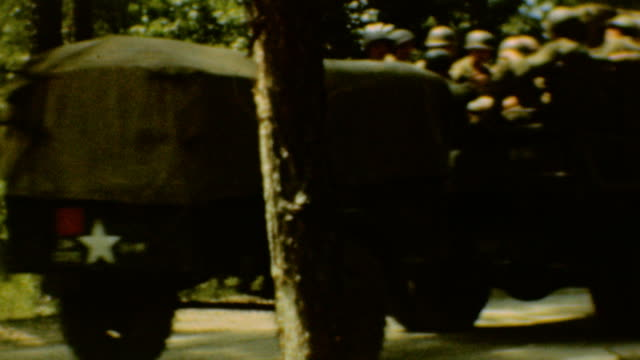 vidéos et rushes de / army trucks navigate through germany during wwii / us army convoy siegfried line on september 01 1944 in germany - 1944