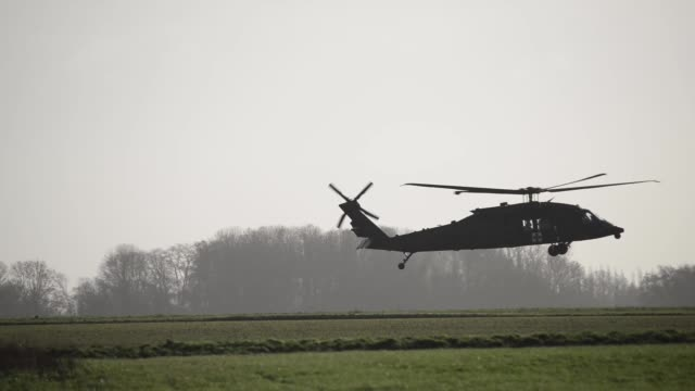 us army uh60 black hawk helicopters from the 1st combat aviation brigade 1st infantry division leave chièvres air base belgium on february 7 2019 to... - operation atlantic resolve stock videos & royalty-free footage