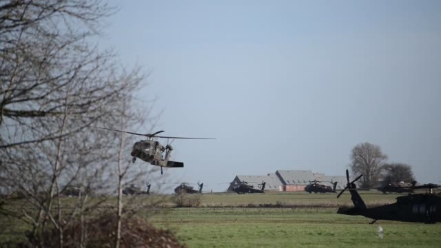 us army uh60 black hawk helicopters from the 1st combat aviation brigade 1st infantry division leave chièvres air base belgium on february 7 2019 to... - infantry stock videos & royalty-free footage