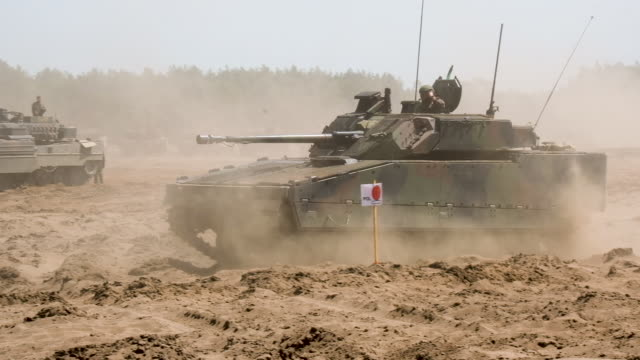 Army units take part in the NATO Noble Jump military exercises during a live fire demonstration on June 12 2019 in Zagan Poland The exercises include...