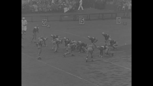 army v notre dame / army marching band on field / cadet feet marching around muddy field / stands with women in raincoats and hats and men with... - cadet stock videos & royalty-free footage