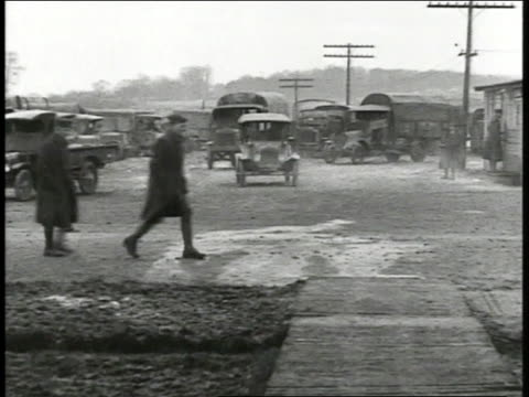 army vehicles cars trucks moving forward out of parked area - 1918 stock videos and b-roll footage