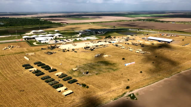 US Army vehicles sit at a military camp under construction at the USMexico border on November 7 2018 in Donna Texas The forward operating base is...