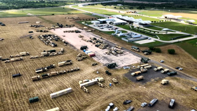us army vehicles sit at a military camp under construction at the usmexico border on november 7 2018 in donna texas the forward operating base is... - international border stock videos & royalty-free footage