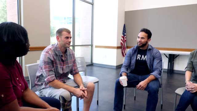 army veteran discusses experiences during support group meeting for veterans - war veteran stock videos & royalty-free footage
