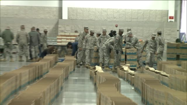 army volunteers package food items in boxes to deliver to charities in new york state new york state partners with walmart pepsico and freshdirect to... - thanksgiving politics stock videos & royalty-free footage