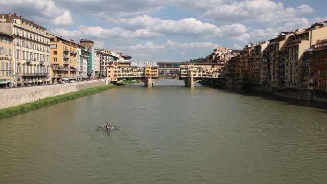 arno river, downstream, ponte vecchio bridge, florence, italy - ponte stock-videos und b-roll-filmmaterial