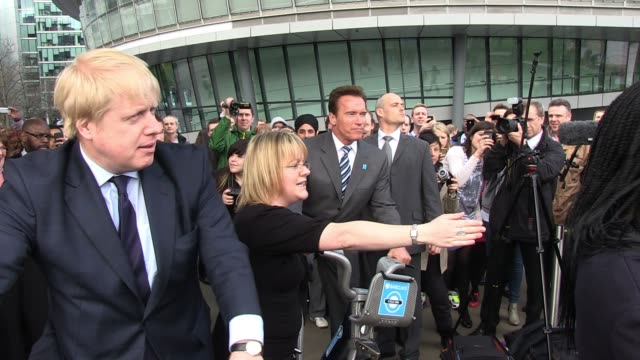 Arnold Schwarzenegger and Boris Johnson arrive for the photo call at Potter's Field to promote Barclays green energy Arnold Schwarzenegger meets...