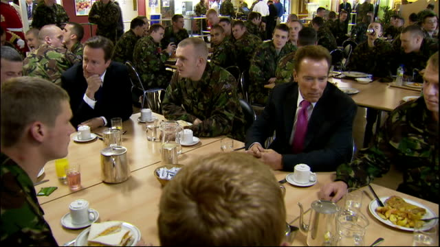 Arnold Schwarzenegger and David Cameron visit Wellington Barracks INT **BEWARE FLASH PHOTOGRAPHY** Various of Schwarzenegger and Cameron chatting to...