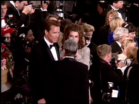 arnold schwarzenegger at the 1995 academy awards arrivals at the shrine auditorium in los angeles, california on march 27, 1995. - shrine auditorium stock videos & royalty-free footage