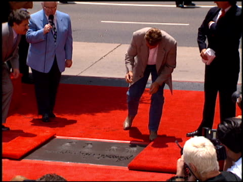arnold schwarzenegger at the dedication of arnold schwarzenegger's footprints at grauman's chinese theatre in hollywood, california on july 14, 1994. - arnold schwarzenegger stock videos & royalty-free footage