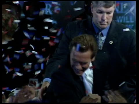 arnold schwarzenegger elected california governor; itn tms schwarzenegger and wife maria shriver on stage as tickertape falls tgv tickertape and... - governor stock videos & royalty-free footage