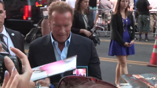 arnold schwarzenegger greets fans at the expendables 3 premiere in hollywood in celebrity sightings in los angeles - arnold schwarzenegger stock-videos und b-roll-filmmaterial