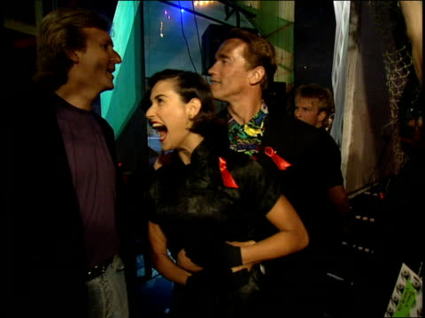 Arnold Schwarzenegger Holding Demi Moore Backstage at 1992 MTV Movie Awards