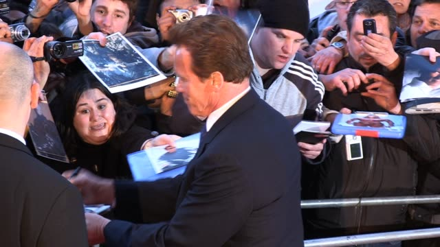 arnold schwarzenegger poses for photos and signs for fans at the arrivals for gorby 80 at the royal albert hall arnold schwarzenegger at royal albert... - arnold schwarzenegger stock-videos und b-roll-filmmaterial