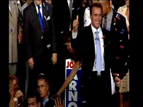 arnold schwarzenegger shakes hands and waves to supporters after becoming the new governor of california october 03 - arnold schwarzenegger stock-videos und b-roll-filmmaterial