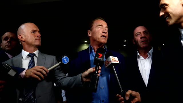 Arnold Schwarzenegger speaks to the media as he arrives at Melburne International Airport on March 16 2018 in Melbourne Australia
