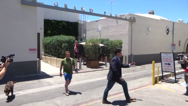 Arnold Schwarzenegger takes his dog for a walk while shopping in Beverly Hills in Celebrity Sightings in Los Angeles