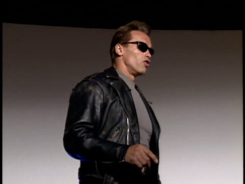 arnold schwarzenegger talks about the first film, says i told you i'll be back. - arnold schwarzenegger stock-videos und b-roll-filmmaterial
