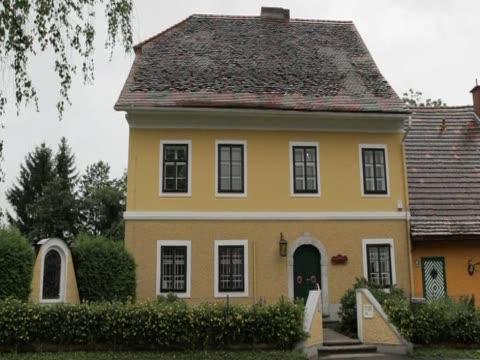 arnold schwarzenegger's childhood home becones a museum austria - arnold schwarzenegger video stock e b–roll
