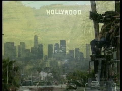 Arnold Schwazenegger bid to become Governor of California LIB California Los Angeles Following seq has music overlaid 'Hollywood' sign on hillside...